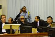 Nuon Chea and his two Co-Lawyers awaits the verdict in Case 002/01.